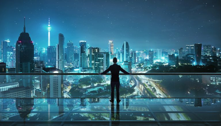 illustration of man in suit looking over glass balcony railing at busy city skyline at night